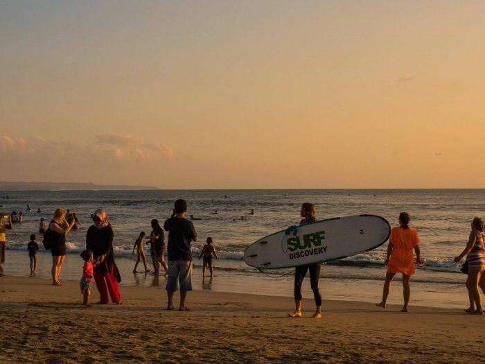 surfing in kuta beach